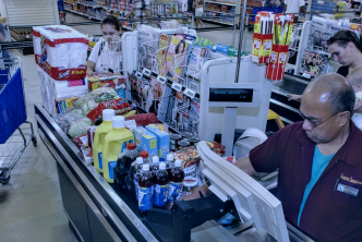 A Navy family unloads their shopping cart while purchasing groceries at the Navy Commissary located just outside Naval Air Station Oceana. U.S. Navy photo by Photographer's Mate 1st Class Michael W. Pendergrass.