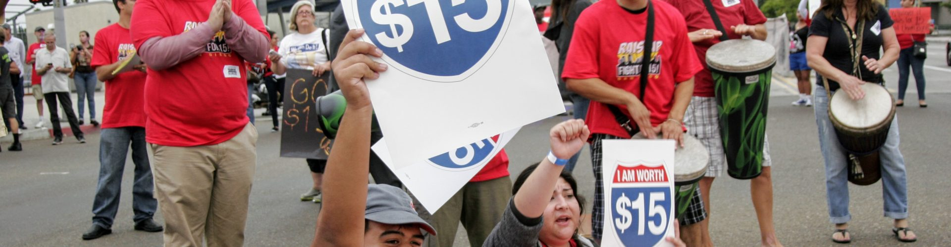 Residents rally for increasing minimum wage in the City Heights neighborhood of San Diego